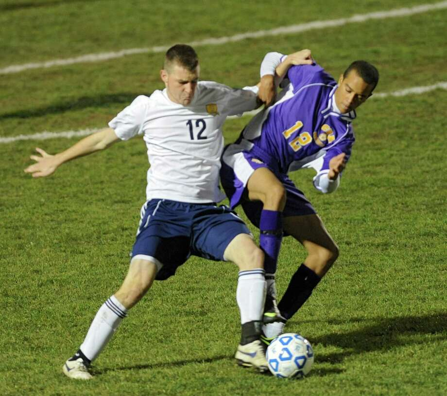 Averill Park's Owen Nuss, left, battles for the ball with (Syracuse) CBA's Monte Stroman during the boys' soccer Class A regional on Wednesday, Nov. 6, 2013 in Colonie, N.Y.  (Lori Van Buren / Times Union) Photo: Lori Van Buren / 00024528A