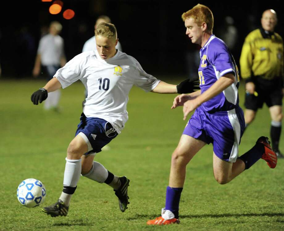 Averill Park's Josh Lionarons, left, battles for the ball with (Syracuse) CBA's Barnes Werner during the boys' soccer Class A regional on Wednesday, Nov. 6, 2013 in Colonie, N.Y.  (Lori Van Buren / Times Union) Photo: Lori Van Buren / 00024528A