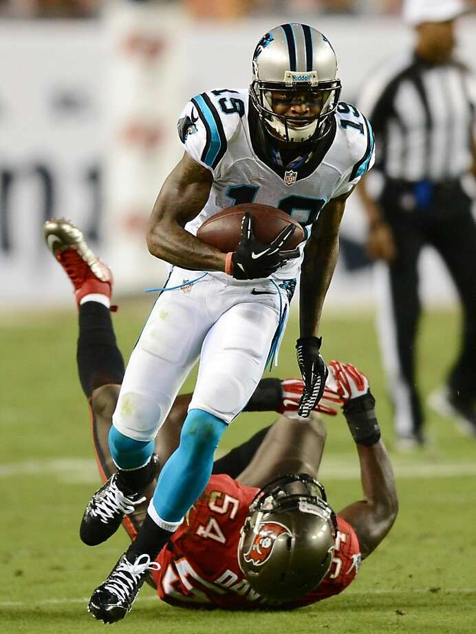 Carolina Panthers wide receiver Ted Ginn Jr. breaks free of a tackle attempt by the Tampa Bay Buccaneers' Lavonte David during the second quarter at Raymond James Stadium in Tampa, Florida, on Thursday, October 24, 2013. (Jeff Siner/Charlotte Observer/MCT) Photo: Jeff Siner, McClatchy-Tribune News Service