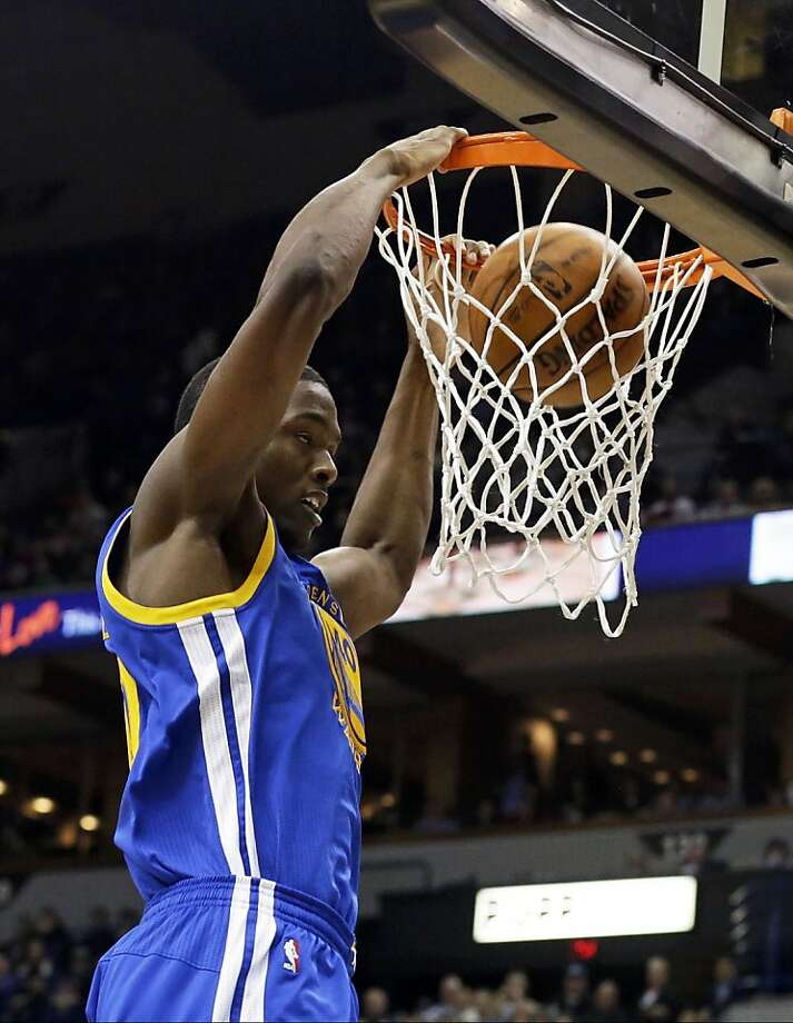 Harrison Barnes slams in two points during his season debut Wednesday. Photo: Jim Mone, Associated Press