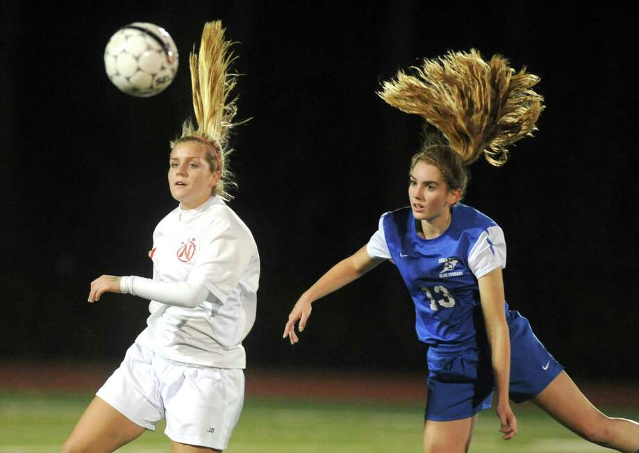 Niskayuna's Maddie Karafanda, left, and Saratoga's Theresa Starnes battle for the ball during their Class AA Section II girls' soccer finals on Wednesday Nov. 6, 2013 in Stillwater, N.Y. (Michael P. Farrell/Times Union) Photo: Michael P. Farrell / 00024513A