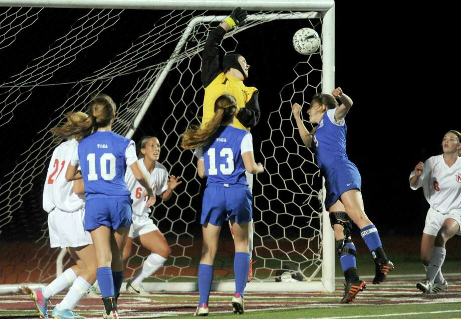 Niskayuna's goalkeeper Kristen Hartlage block a shot during their Class AA Section II girls' soccer finals against Saratoga Springs on Wednesday Nov. 6, 2013 in Stillwater, N.Y. (Michael P. Farrell/Times Union) Photo: Michael P. Farrell / 00024513A