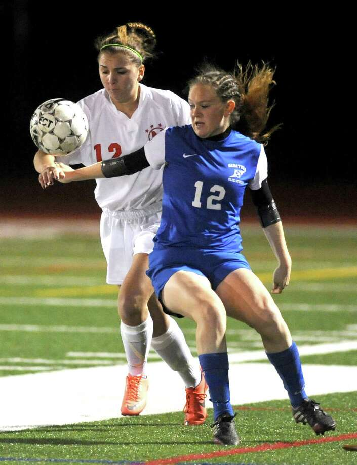 Niskayuna's Julia Rinaolo, left, and Saratoga's Kennedy Cocozzo battle for the ball during their Class AA Section II girls' soccer finals on Wednesday Nov. 6, 2013 in Stillwater, N.Y. (Michael P. Farrell/Times Union) Photo: Michael P. Farrell / 00024513A