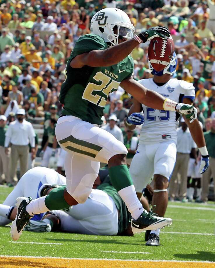 It's a double-edge sword that defenses trying to control Baylor face as Lache Seastrunk, left, leads a rushing attack that ranks seventh nationally and is a perfect complement to the passing of Bryce Petty, the triggerman for the top-ranked passing game. Photo: Jerry Larson, MBO / Waco Tribune Herald