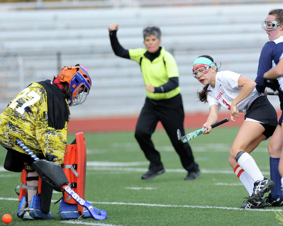 Sydney Cole of Greenwich, right, shoots and scores a goal past Jodie Baris in the Class L field hockey playoff between Greenwich and Staples, Wednesday, Nov. 6. Photo: Bob Luckey / Greenwich Time
