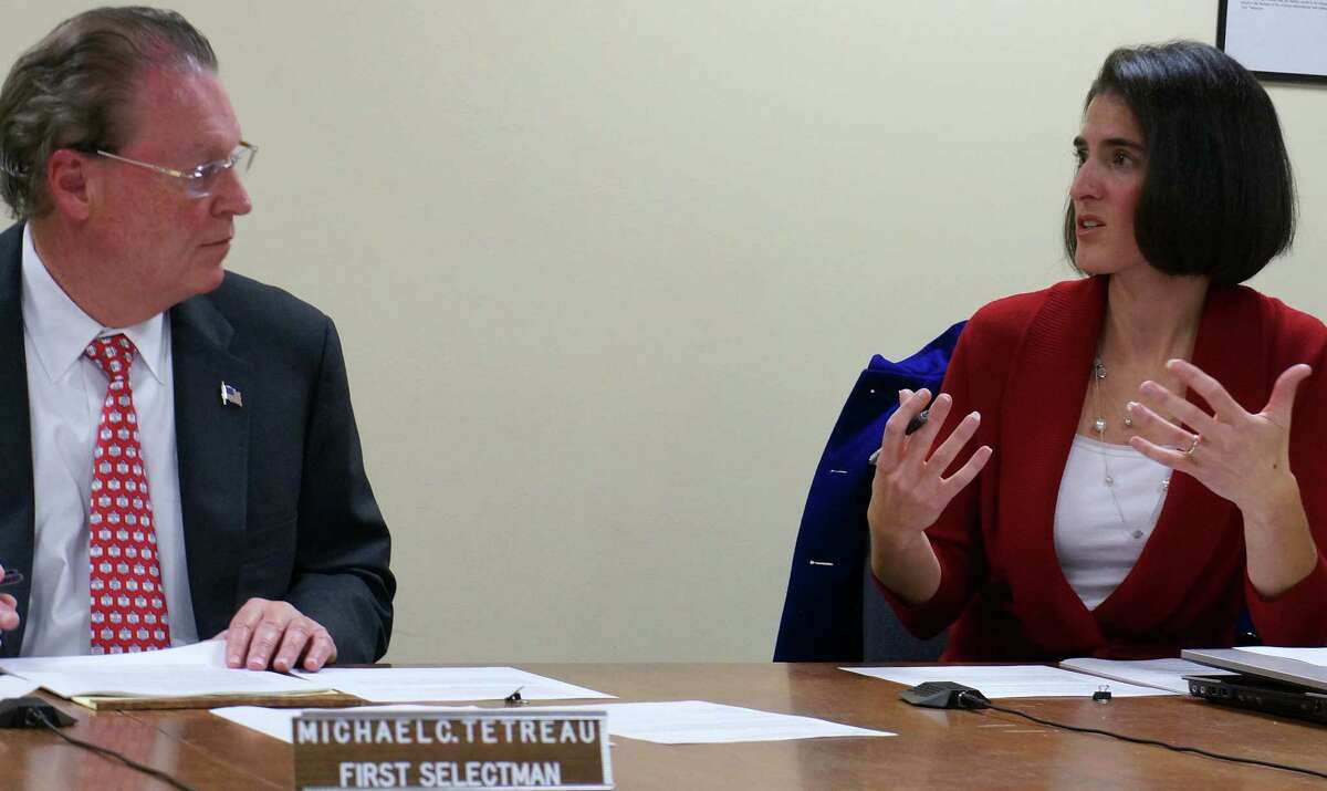 Selectman Cristin McCarthy Vahey makes a point, as First Selectman Michael Tetreau listens, during a Wednesday discussion of a new committee that will plan repairs to storm-damaged Penfield Pavilion.