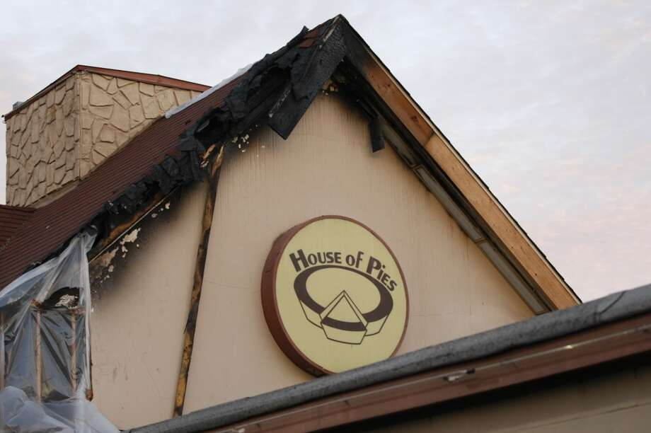 Officials say flames heavily damaged the roof and outer portions of the eatery. Photo: Johnny Hanson, Houston Chronicle