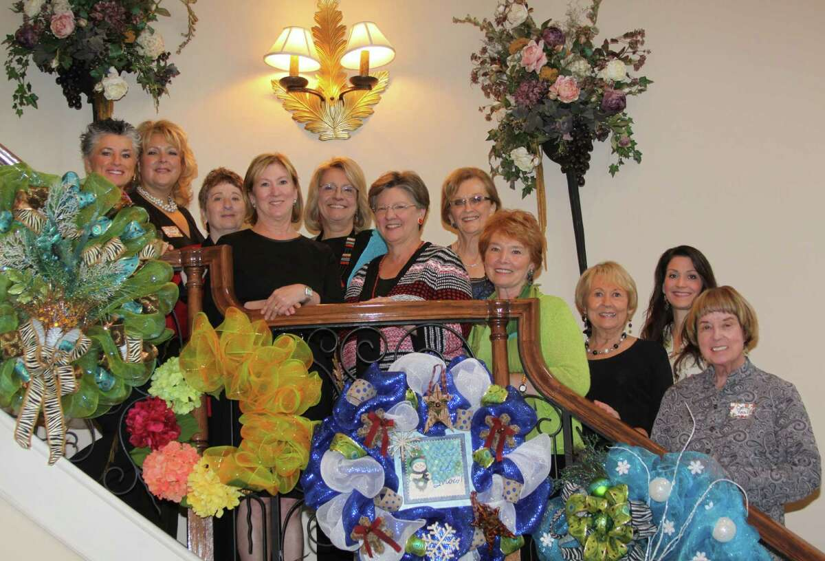 Friends Council members, from left, Pat Somers, Linda Page, Sue Hauenstein, Peggy Jackson, Karen Shaw, Lynn Halford, Janice King, Joyce Ericsson, Gerri Brecker, Danielle Hames and Cathy Yasilli welcomed guests to the coffee. They are pictured with some of the wreaths made by demonstrator Judy Maddison.