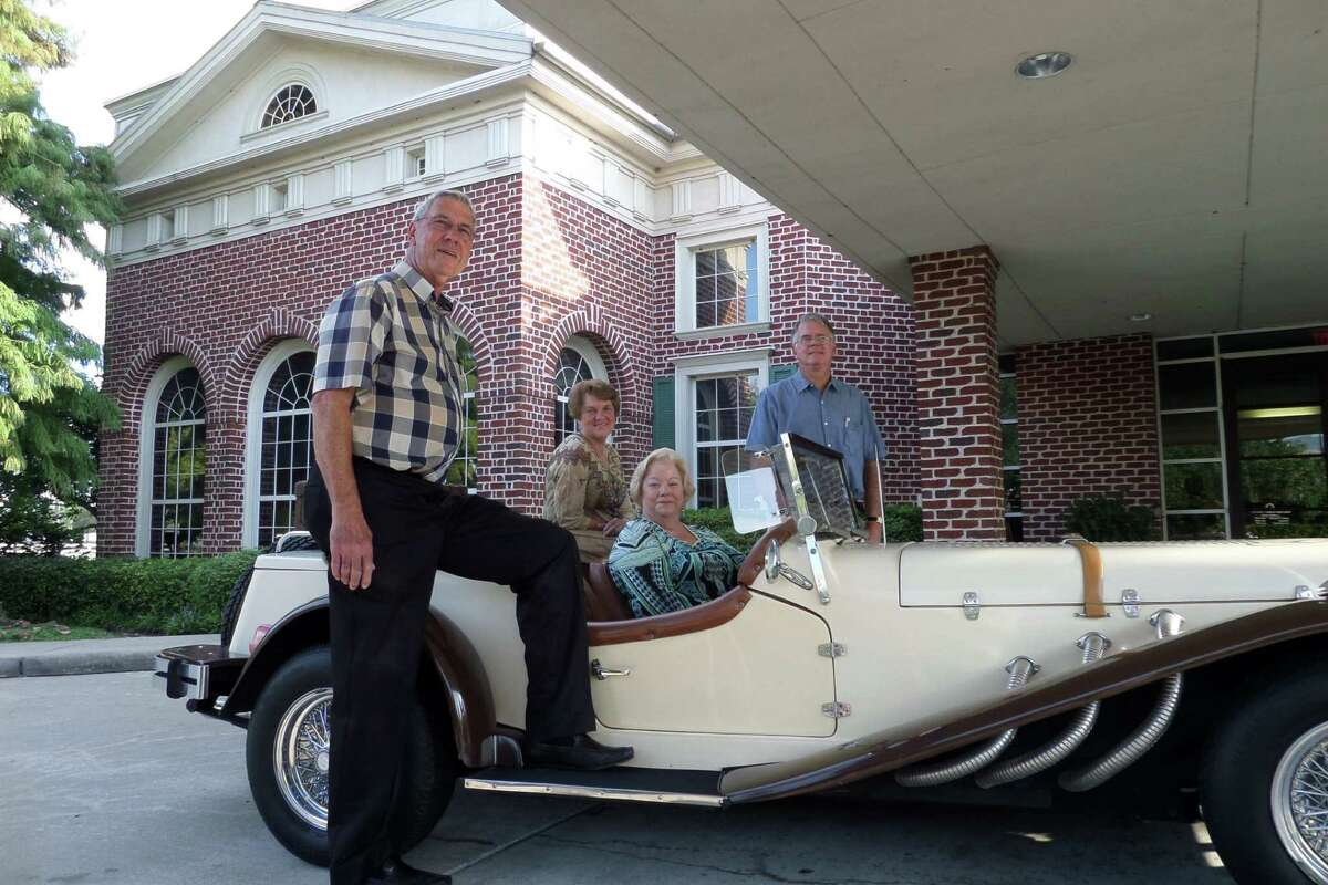 """From left, Arc """"Best in the West"""" co-chairs James Patterson, Ann Smith and Jo Ann Stevens, seated in the car, show off the replica of a 1929 Mercedes convertible, which will be raffled. Arc supporter Mike Casey is in the back."""