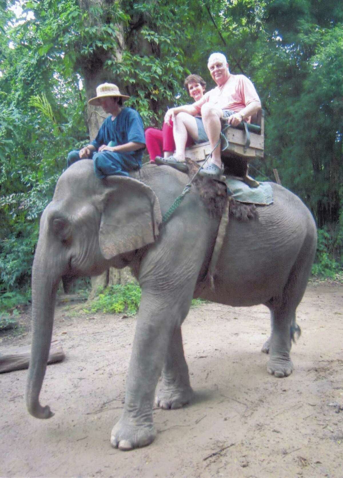Diana and John Null, who bought last year's auction item to Bali and Singapore, enjoyed a once in a lifetime experience riding on an elephant. The same item, with some added destinations, is being offered this year.