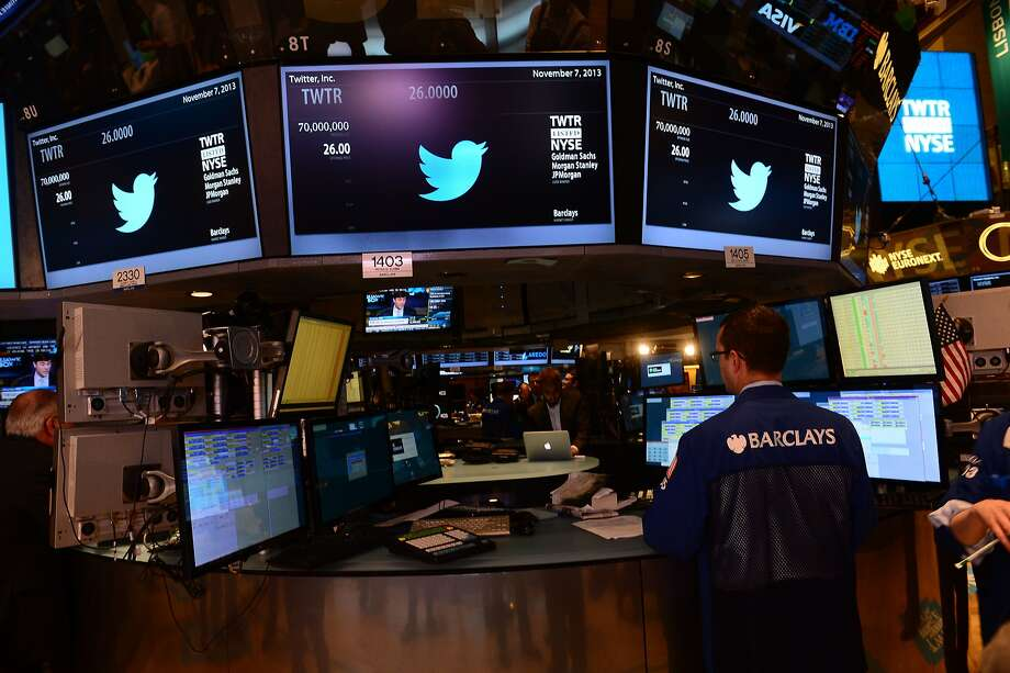 Traders are shown with the logo of Twitter and the symbol on which Twitter's stock will be traded (TWTR) on the floor of the New York Stock Exchange (NYSE) on November 7, 2013 in New York. Twitter goes public on the NYSE today,and is expected to open at $26 per share, making the company worth an estimated 18 billion USD. AFP PHOTO/EMMANUEL DUNANDEMMANUEL DUNAND/AFP/Getty Images Photo: Emmanuel Dunand, AFP/Getty Images
