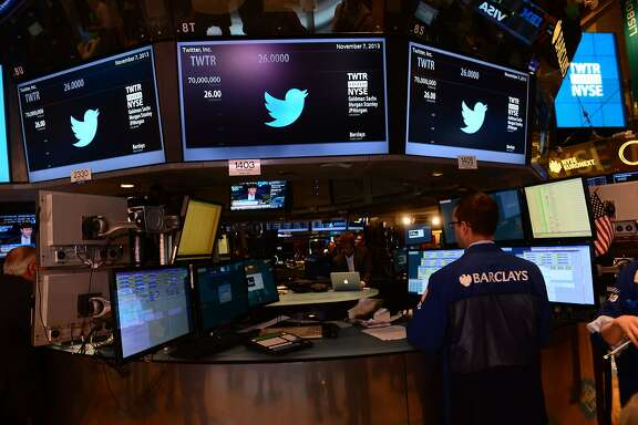 Traders are shown with the logo of Twitter and the symbol on which Twitter's stock will be traded (TWTR) on the floor of the New York Stock Exchange (NYSE) on November 7, 2013 in New York. Twitter goes public on the NYSE today,and is expected to open at $26 per share, making the company worth an estimated 18 billion USD. AFP PHOTO/EMMANUEL DUNANDEMMANUEL DUNAND/AFP/Getty Images