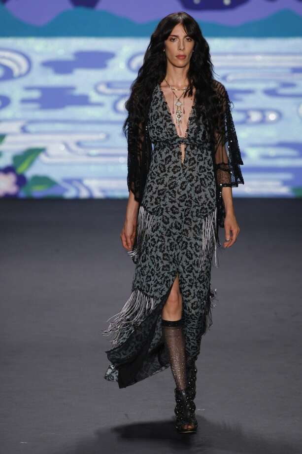 A model walks the runway at the Anna Sui show during Spring 2014 Mercedes-Benz Fashion Week at The Theatre at Lincoln Center on September 11, 2013. The collection was inspired by Sui's interest in Pre-Raphaelite paintings, Art Nouveau and the tapestry collection of Led Zeppelin guitarist Jimmy Page. Photo: Edward James, WireImage
