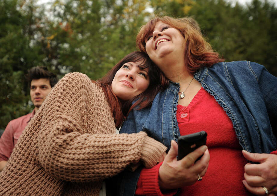 Breanne Milyo, left, and her mother Teresa Milyo, both of Shelton, watch the removal of the new Rockefeller Center Christmas tree at 15 Kazo Drive in Shelton, Connecticut on Thursday, November 7, 2013. Photo: Brian A. Pounds / Connecticut Post