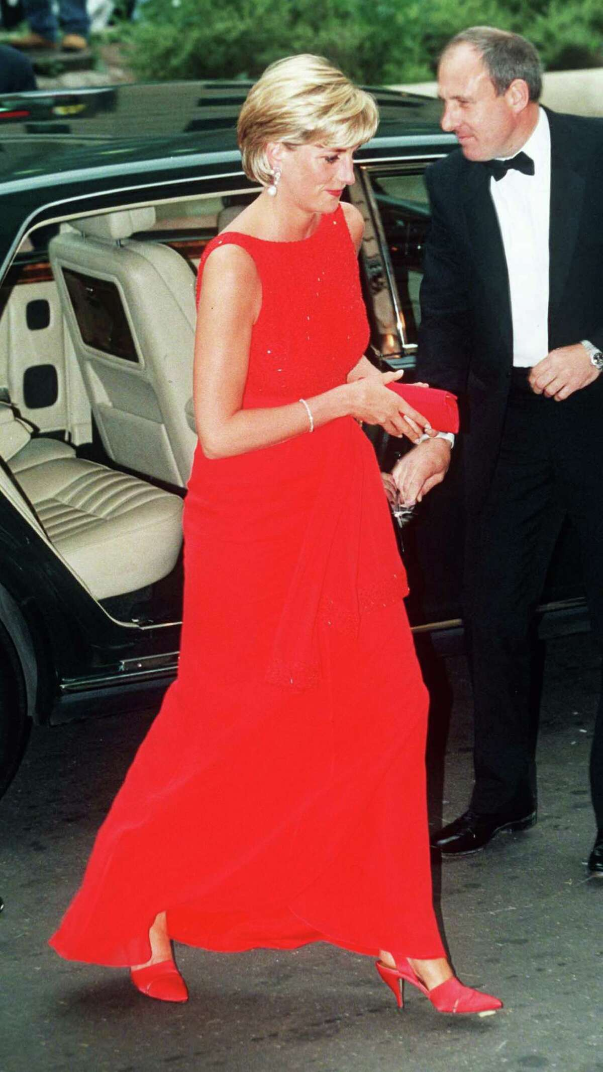 """Above: The late Princess of Wales was known to wear dresses and gowns created by Jacques Azagury. The London designer recreated some of Diana's gowns for the big screen movie """"Diana,"""" in theaters now."""