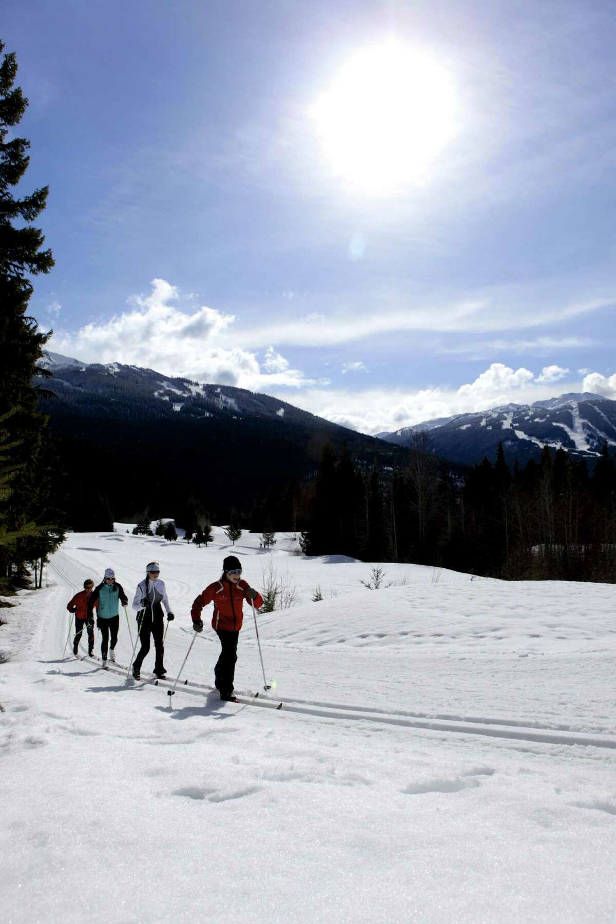 A family enjoys the cross-country skiing trails at Lost Lake in Whistler.