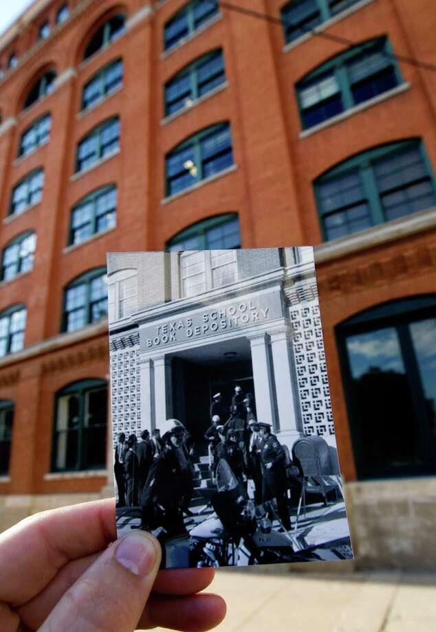 In this photo by Dallas Times Herald photographer William Allen police and detectives guard the front entrance to the Texas School Book Depository building less than an hour after the assassination, Tuesday, Sept. 10, 2013, in Dallas. Dallas Police officer M.N. McDonald, right, went to Oak Cliff to investigate after hearing on the police radio that an officer had been shot there. Photo: Cody Duty, Houston Chronicle / © 2013 Houston Chronicle