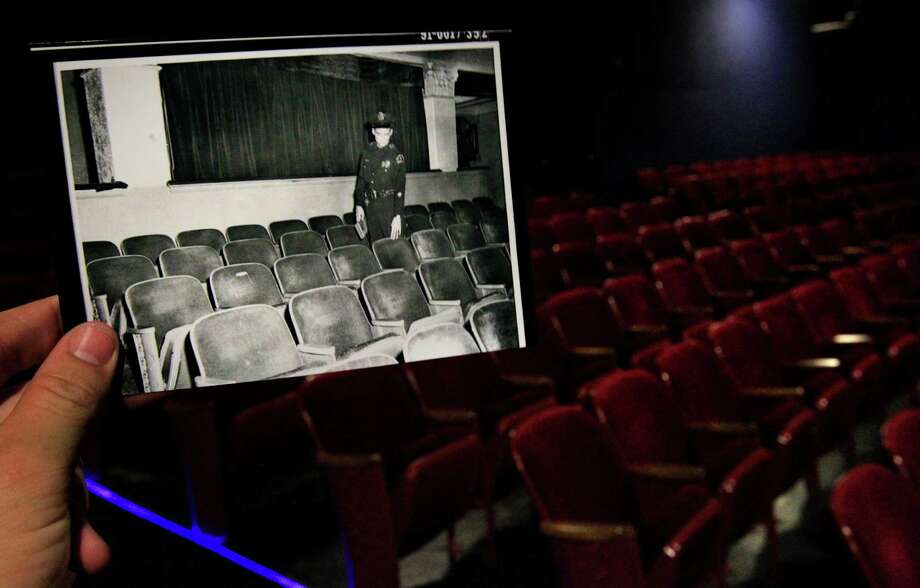 "A photo originally shot in 1963 by R.W. ""Rusty"" Livingston Collection/The Sixth Floor Museum at Dealey Plaza at the Texas Theatre is juxtaposed against the current day theatre Monday, Sept. 9, 2013, in Dallas. In the original photo, a policeman stands beside Oswald's seat in the theatre. Police arrested Oswald for the assassination of president John F. Kennedy at the theatre. Photo: Cody Duty, Houston Chronicle / © 2013 Houston Chronicle"