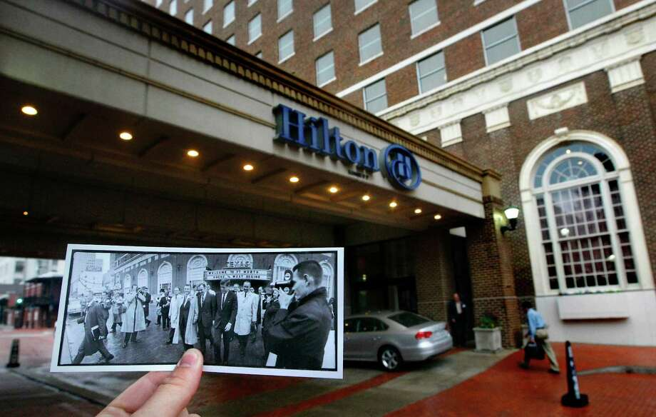 A photo of President John F. Kennedy, followed by Vice President Lyndon Johnson, walking from the The Hotel Texas, November 22, 1963 is juxtaposed against the modern day Hilton, Tuesday, Nov. 5, 2013, in Fort Worth. He spent his last night on the eighth floor of the hotel before heading to Dallas where he was assassinated later that day. Photo: Cody Duty, Houston Chronicle / © 2013 Houston Chronicle