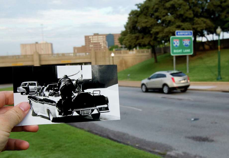 "In this photo by Ike Altgens of the Associated Press, juxtaposed with the current scene taken on Tuesday, Sept. 10, 2013,  Jackie Kennedy and Secret Service Agent Clint Hill climb on the back of the limousine after a fatal shot hit President John F. Kennedy, in Dallas. Atgens was standing on Elm Street when he heard a blast that he recognized as gunfire and saw the President had been struck in the head. ""I had pre-focused, had my hand on the trigger, but when JFK's head exploded, sending substance in my direction, I virtually became paralyzed,"" Altgens later told author Richard B. Trask. ""This was such a shock to me that I never did press the trigger on the camera."" Seconds later Atgens recomposed himself and shot the picture being held in this photo. Photo: Cody Duty, Houston Chronicle / © 2013 Houston Chronicle"