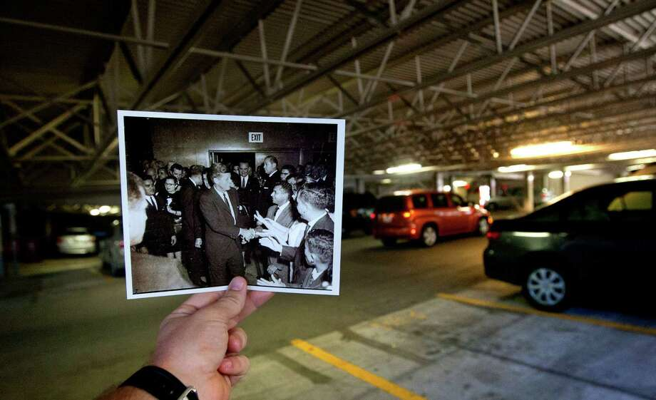 A photo by Alexander Arroyos depicting President John F. Kennedy and first lady Jacqueline Kennedy in the Grand Ballroom at the Rice Hotel on Nov. 21, 1963, is juxtaposed against the current parking garage at the Rice Hotel, Tuesday, Oct. 22, 2013, in Houston. The Grand Ballroom no longer exists after the hotel was remodeled making it into a parking garage. Photo: Cody Duty, Houston Chronicle / © 2013 Houston Chronicle