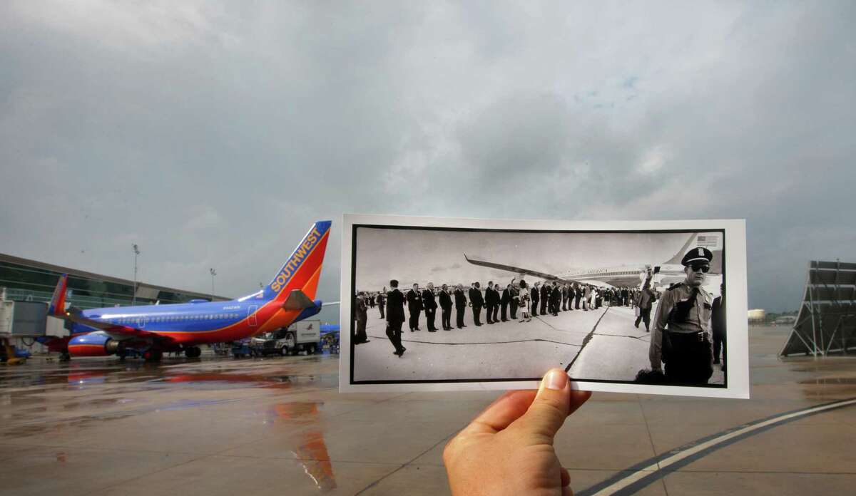 A photo showing President John F. Kennedy shaking hands with 22 prominent Houstonians after he and First Lady Jacqueline Kennedy arrived at Houston International Airport, in Houston, November 21, 1963 is juxtaposed against the current day William P. Hobby Airport, Wednesday, Oct. 30, 2013, in Houston. The airport's name was changed to William P. Hobby Airport in 1967 in honor of the Texas governor, and the current-day terminal was finished in 2003. The original location where Air Force One was parked in the original photo is no longer an open area, it is now a parking toll plaza.