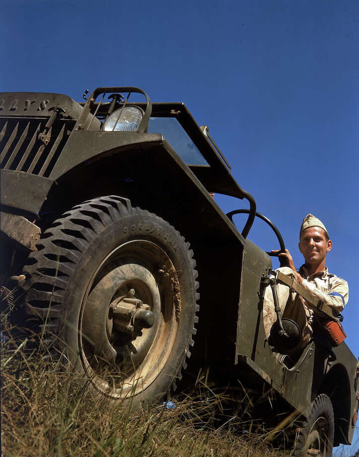 An American soldier sits behind the wheel of a Willys MB jeep, shortly before the United States joined World War II, 1941. Photo: Robert Yarnall Richie, Time & Life Pictures/Getty Image / Time & Life Pictures