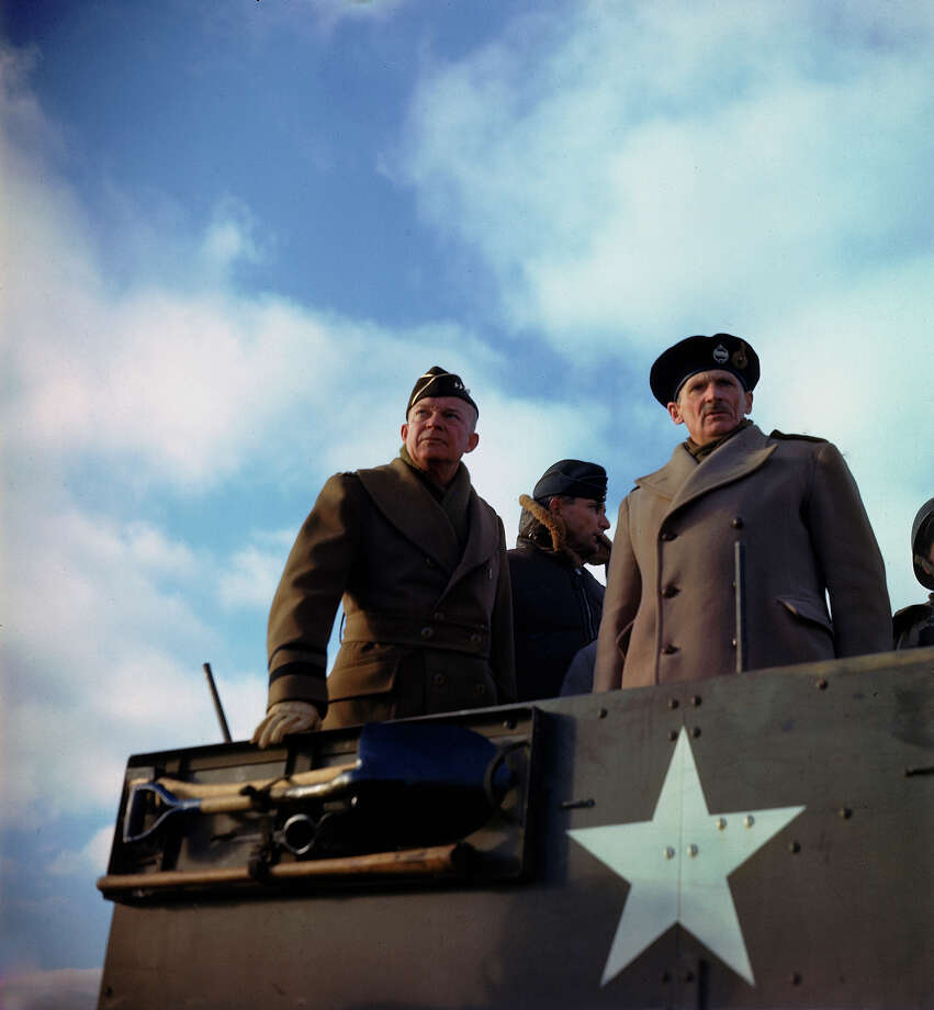 Supreme Allied Commander American General Dwight D. Eisenhower, his deputy, British Chief Air Marshal Arthur Tedder , and the principal commander of Allied ground forces in Europe, British General Bernard L. Montgomery, stand in a US armored vehicle as they review a tank exercise, Salisbury, England, 1944. Photo: Frank Scherschel., Time & Life Pictures/Getty Image / Time Life Pictures