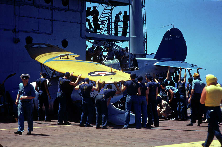 Crew removing plane which has made a slight crash landing aboard the aircraft carrier Enterprise CV-6 during the US Navy's Pacific Fleet maneuvers in 1940. Photo: Carl Mydans, Time & Life Pictures/Getty Image / Time Life Pictures