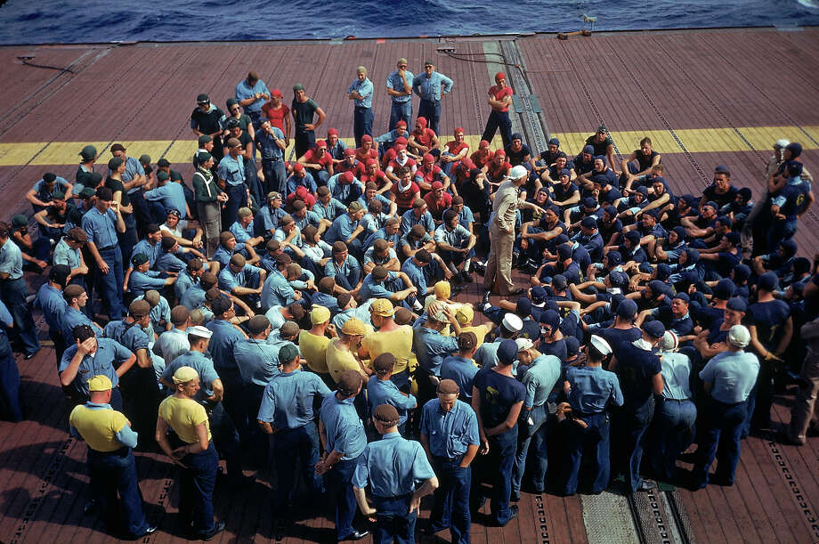 Crew aboard the aircraft carrier Enterprise CV-6 listening to instructions during the US Navy's Pacific Fleet maneuvers around Hawaii in 1940. Photo: Carl Mydans, Time & Life Pictures/Getty Image / Time Life Pictures