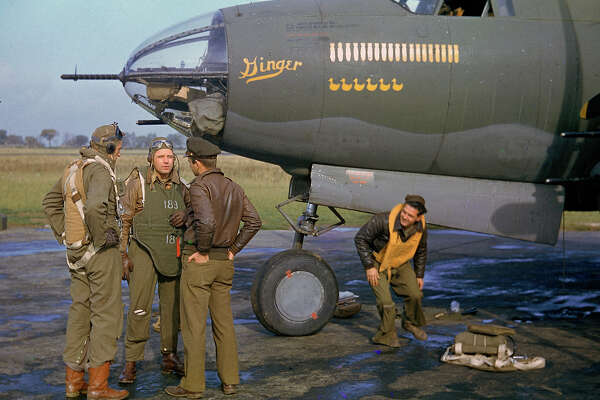 Date taken: 1944 Description: Crew of a B-26 Marauder outside their plane, nicknamed Ginger. cr: Frank Scherschel/Time & Life Pictures/Getty Images OWNED