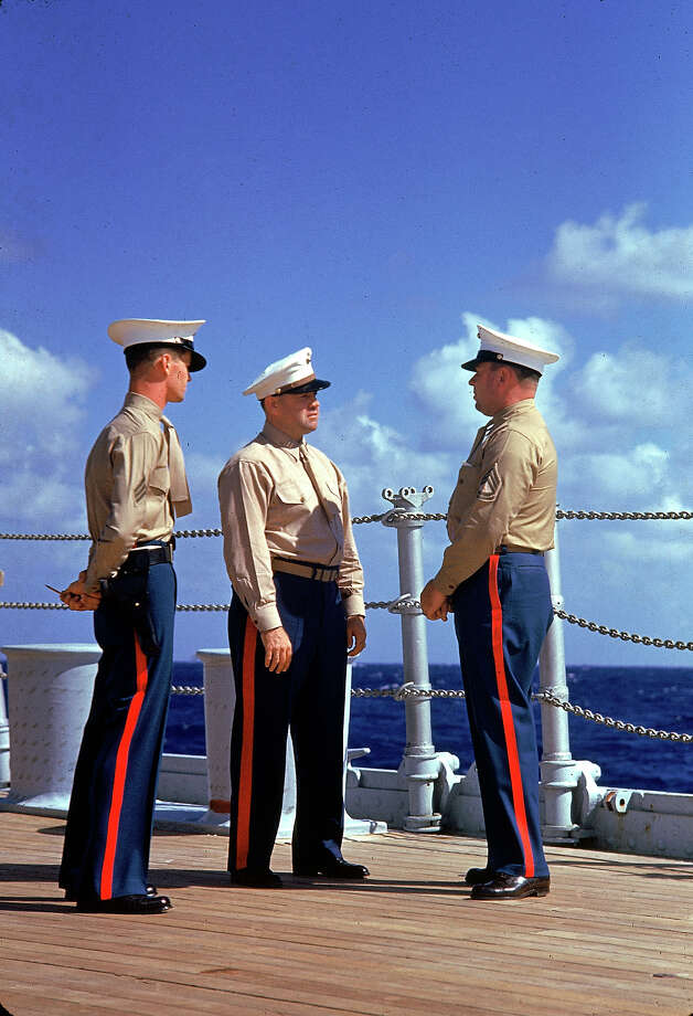 Three American Marines in dress uniforms talk aboard an unidentified ship during the US Navy's Pacific fleet maneuvers near Hawaii, September 1940. Photo: Carl Mydans., Time & Life Pictures/Getty Image / Time Life Pictures