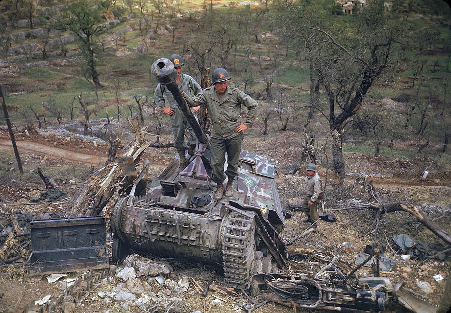 A group of American soldiers inspect heavily damaged and abandoned German armor, Italy, May 1944. Photo: Carl Mydans, Time & Life Pictures/Getty Image / Time & Life Pictures