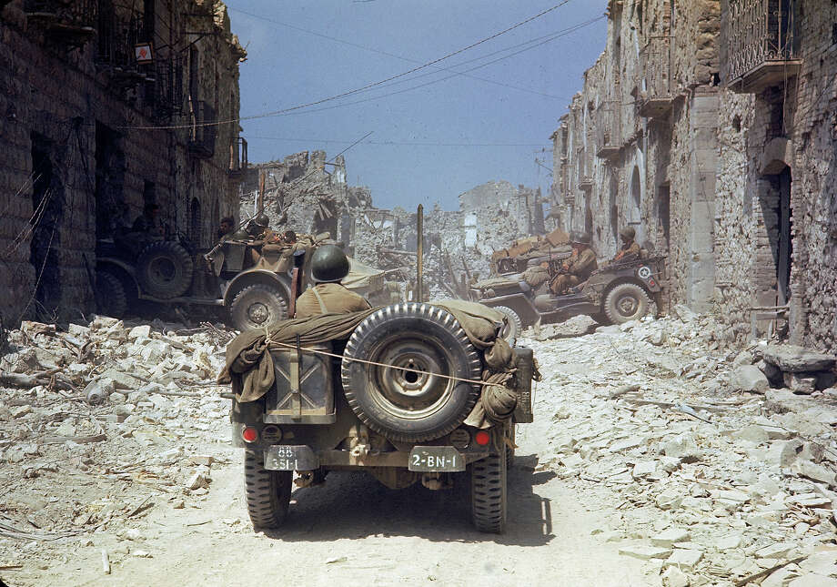 American servicemen drive in jeeps through an unidentified and nearly completely destroyed town, Italy, May 1944. Photo: Carl Mydans, Time & Life Pictures/Getty Image / Time & Life Pictures