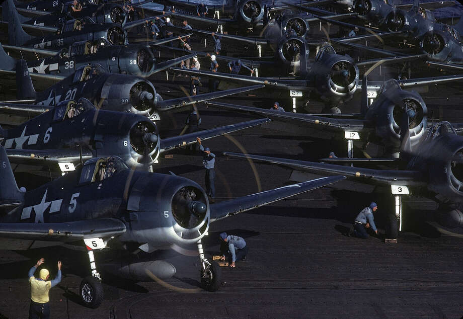 The flight deck crew prepares planes for launch from the USS Lexington (CV-16), en route near New Guinea, early April, 1944. Photo: J. R. Eyerman, Time & Life Pictures/Getty Image / Time & Life Pictures