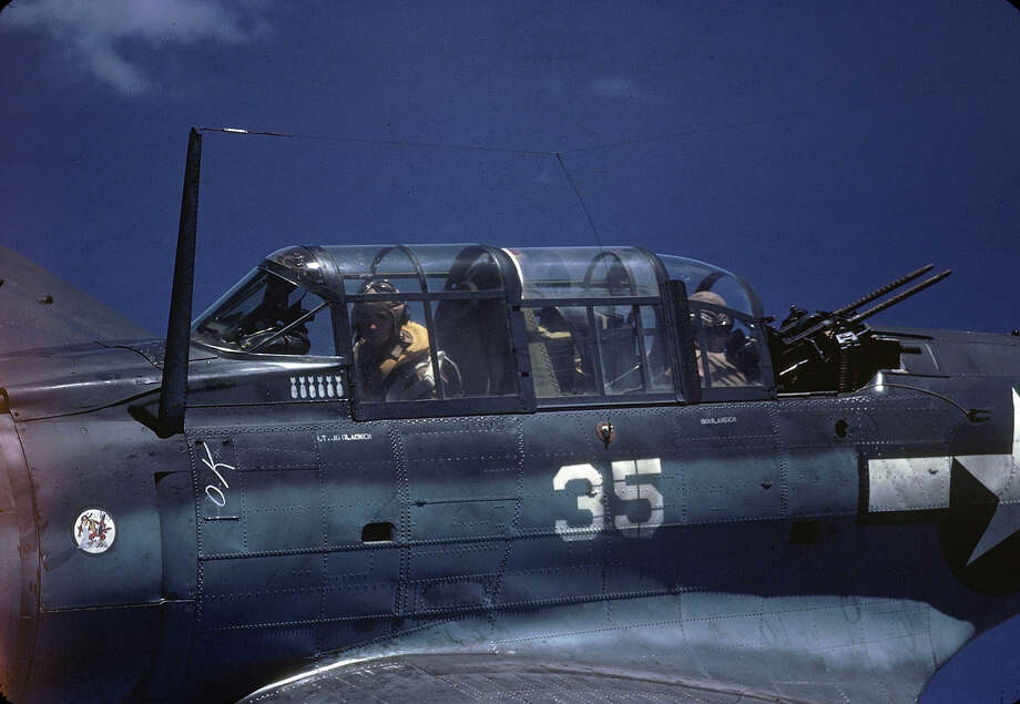 Close-up, in-flight view of a Douglas SBD Dauntless piloted by American Lt. George Glacken (left) with his gunner Leo Boulanger, near New Guinea, early April, 1944. Photo: J. R. Eyerman, Time & Life Pictures/Getty Image / Time & Life Pictures