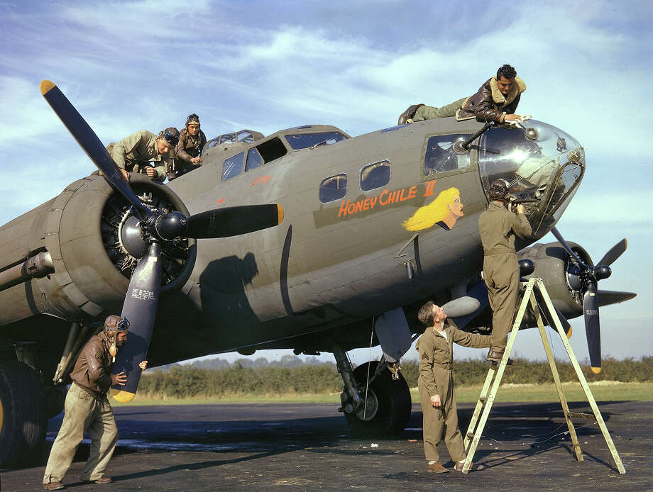 Members of the flight and ground crews of a B-17 bomber named 'Honey Chile II' make adjustments to their plane prior to a mission, Polebrook, Northamptonshire, England, fall 1942. The crew and plane originate from the 97th Bombardment Group of the 8th Bomber Command (later 8th Air Force) which was stationed at Polebrook from June until November of 1942. Photo: Margaret Bourke-White, Time & Life Pictures/Getty Image / Time & Life Pictures