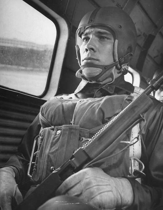 A paratrooper seated on an airplane, waiting to jump, 1940. Photo: Gabriel Benzur, Time & Life Pictures/Getty Image / Gabriel Benzur