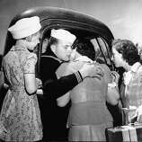 A sailor on leave saying goodbye to his family as his leave comes to an end, 1942