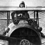 First Lieut. Eddie Rickenbacker, 94th Aero Squadron, American ace w. 26 kills, standing up in cockpit of his French made Spad plane, during WWI, 1918.