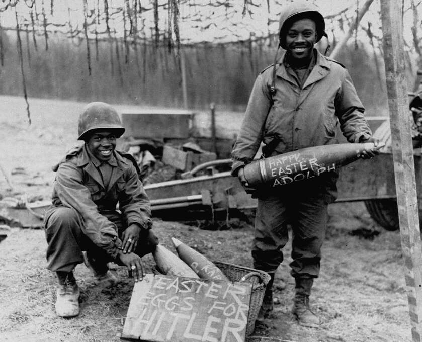 African American soldiers posing in the fields with ammunition shells with the inscription reading Happy Easter Hitler, 1945. Photo: Herbert Orth, Time & Life Pictures/Getty Image / Time Life Pictures