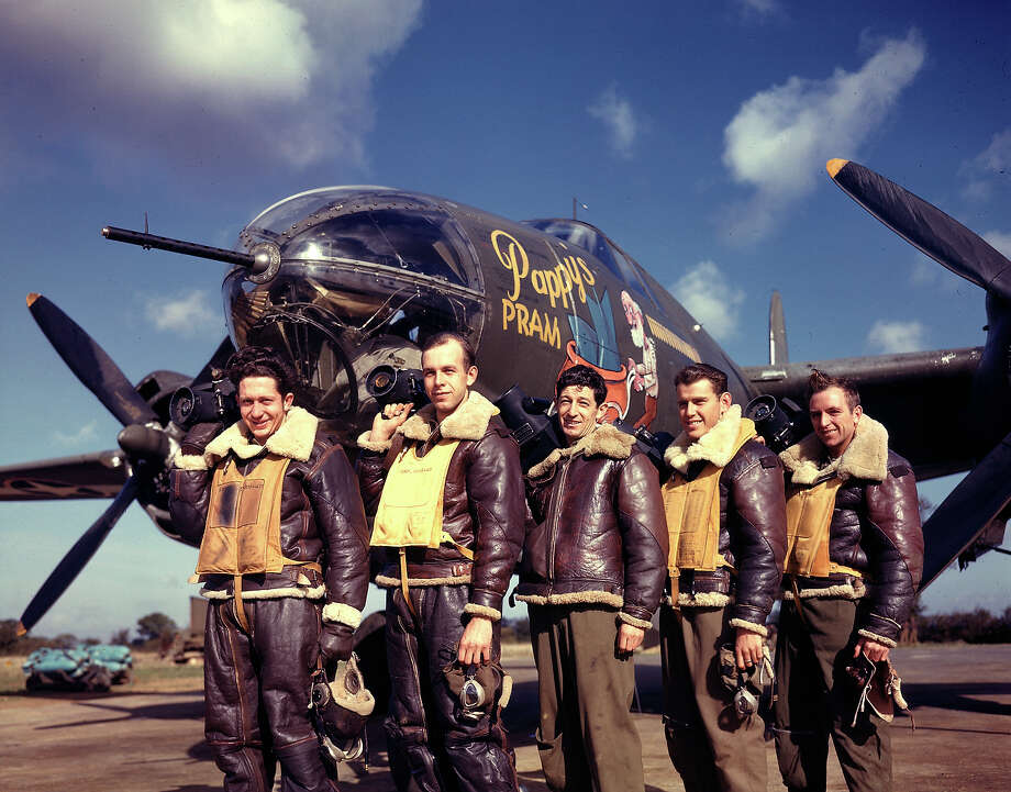 Photographers standing in front of Pappy's Pram, a B-26 Marauder at base, 1943. Photo: Frank Scherschel, Time & Life Pictures/Getty Image / Time Life Pictures
