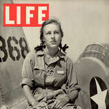 The cover of Life magazine features a photo of American pilot trainee Shirley Slade, in a flight suit and pigtails, as she sits on the wing of her Army trainer at Avanger Field, Sweetwater, Texas, July 19, 1943.