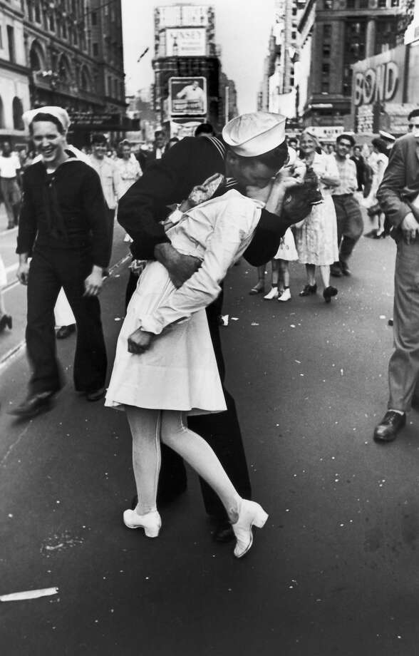 A jubilant American sailor clutching a white-uniformed nurse in a back-bending, passionate kiss as he vents his joy while thousands jam Times Square to celebrate the long awaited-victory over Japan, 1945. Photo: Alfred Eisenstaedt, Time & Life Pictures/Getty Image / Time & Life Pictures