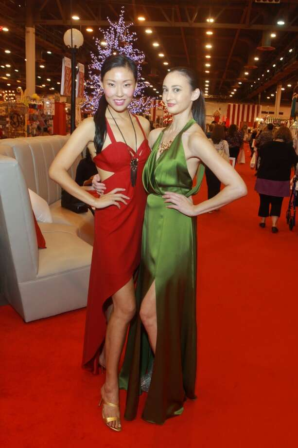 Models Yuan Yuan, left, and Alisa Matthews promoting Fashion Houston at the Houston Ballet Nutcracker Market kick off VIP party. They are both wearing dresses by Chloe Dao. Photo: Gary Fountain, For The Chronicle