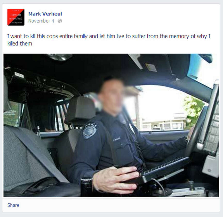 Federal prosecutors in Seattle claim Mark B. Verhul posted the above photo of a Kent police officer, pictured above, as well as disturbing images depicting an officer killed in the line of duty on his Facebook page. Verhul now faces federal charges.