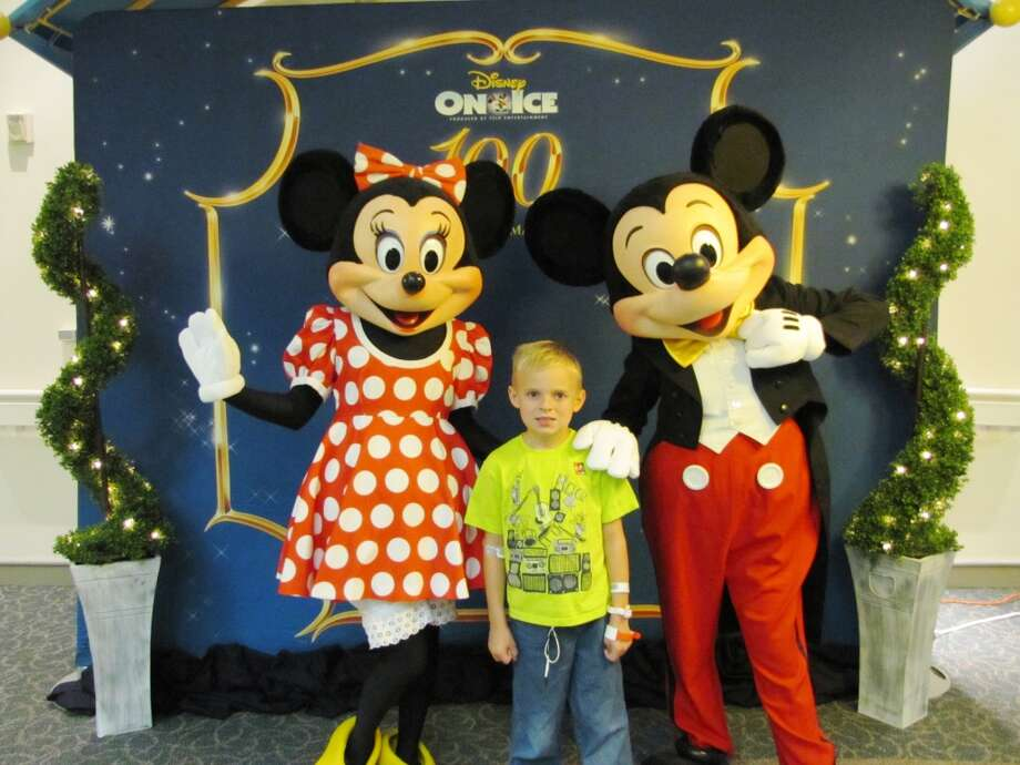A patient, Chase Meetks, 7 years poses with Mickey and Minnie Mouse Photo: Children's Memorial Hermann Hosp
