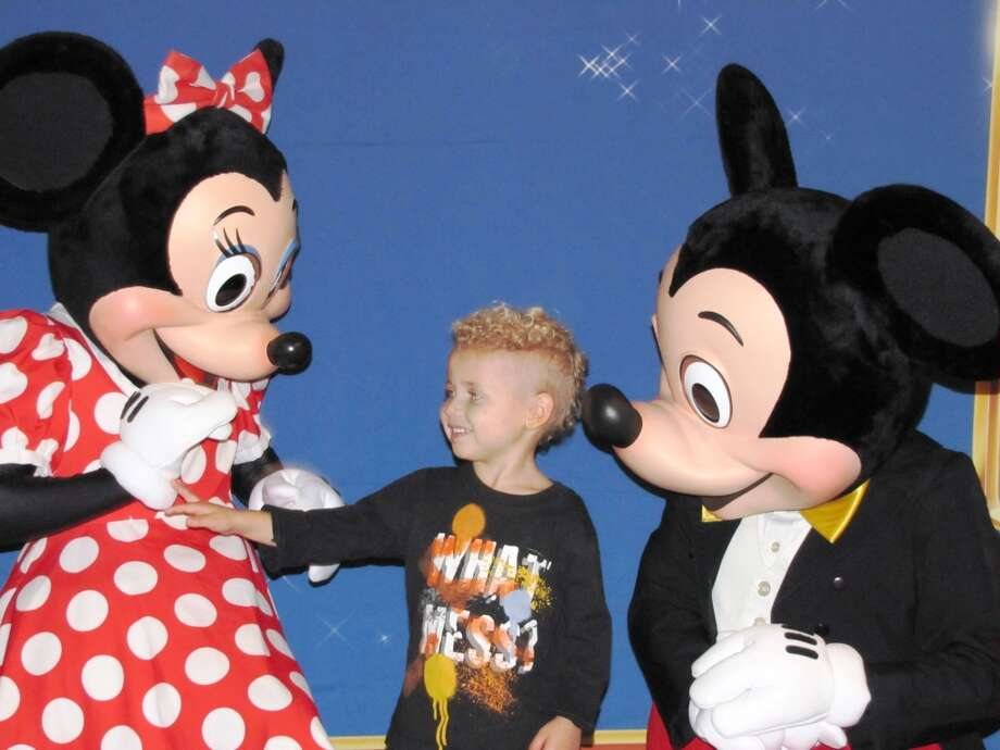 Dorian Pierce, brother of a patient laughs with Mickey and Minnie Mouse Photo: Children's Memorial Hermann Hosp