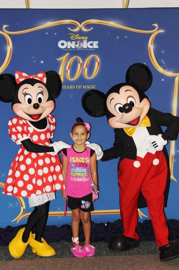 Josaliz Gonzalez with  Mickey and Minnie Mouse Photo: Children's Memorial Hermann Hosp