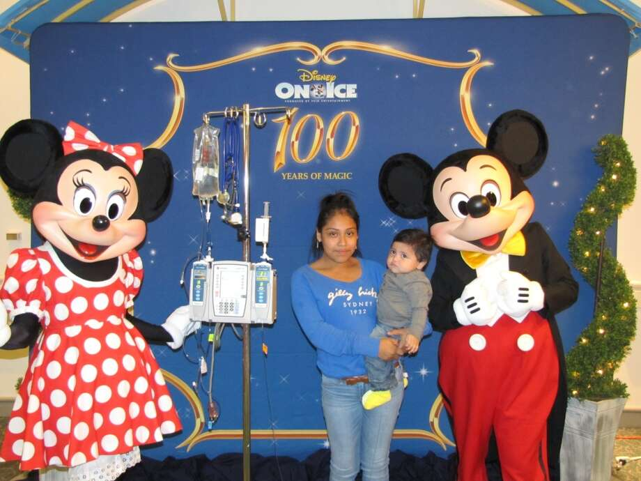 Karina Montellano (mom) with Aiden Montellano, Minnie and Mickey Mouse at Children's Memorial Hermann Photo: Children's Memorial Hermann Hosp
